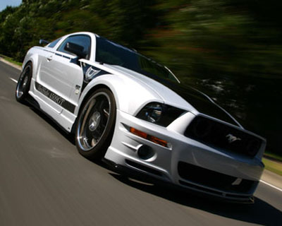 VeilSide 2005-2009 Ford Mustang GT USA Model Complete Kit (FRP) Front Bumper, Side Skirts, Door Panels, Rear Bumper & FRP Hood - AE101