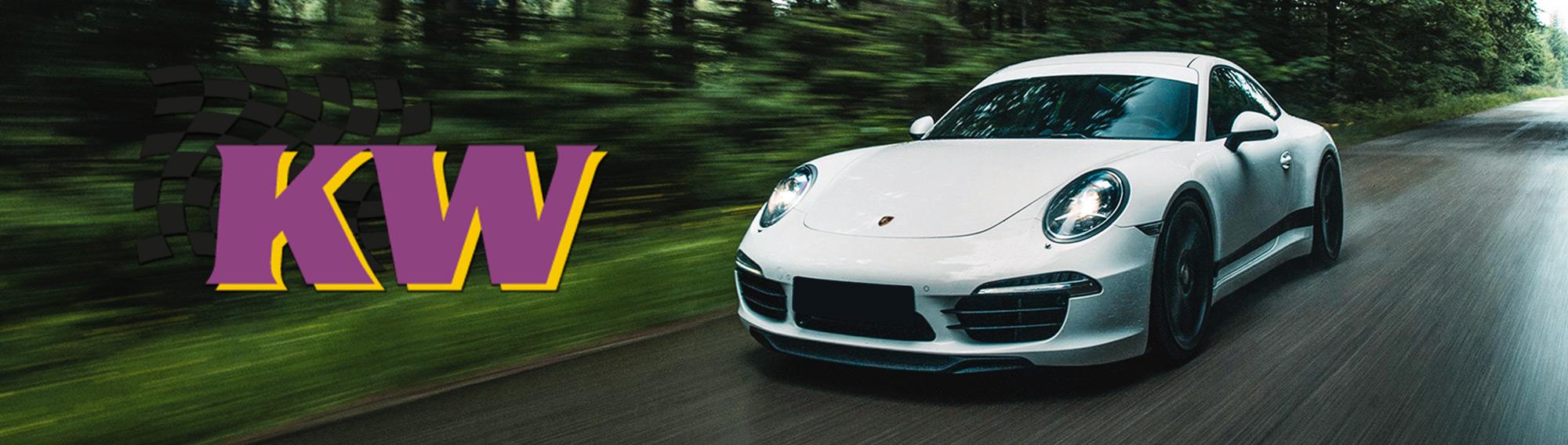 Porsche 991 driving through forest with KW suspension